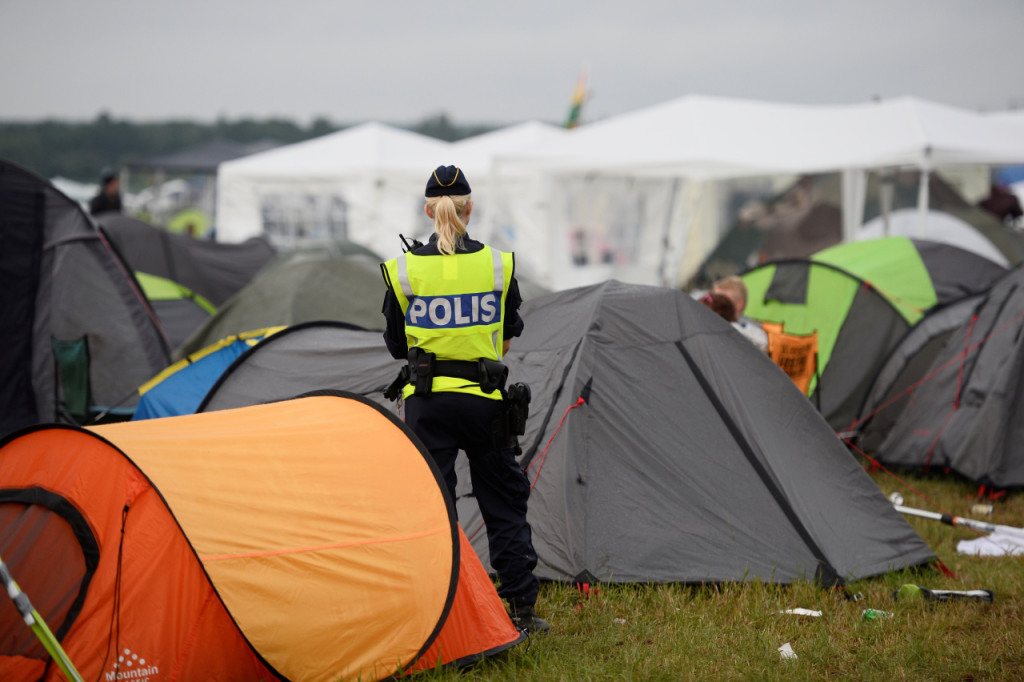 A police officer is seen at the campsite at Bravalla Festival in Norrkoping, Sweden July 1, 2016. Five rapes and a number of sexual assaults were reported at the popular Bravalla Festival over the weekend. TT News Agency/Izabelle Nordfjell/via REUTERS  ATTENTION EDITORS - THIS IMAGE WAS PROVIDED BY A THIRD PARTY. FOR EDITORIAL USE ONLY. SWEDEN OUT. NO COMMERCIAL OR EDITORIAL SALES IN SWEDEN. NO COMMERCIAL SALES. - RTX2JSPN